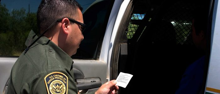 Officer Reading Miranda Rights
